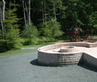 Completed stone patio and gas fire ring (with hydro-seed)