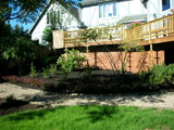 Landscape design, soil grading, plant installation, and pea-gravel pathway