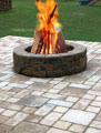 Wood-burning fire pit in new stone patio