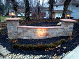 Lighted stone driveway entry wall