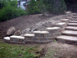 Retaining wall installed along stone stairs
