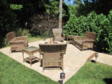Firepit, patio, and privacy shrubs